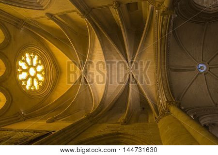 CUENCA SPAIN - August 24 2016: Detail of stained glass window and Vaults of the Transept in the interior of the Cathedral of Our Lady of Grace and Saint Julian of Cuenca. Castilla-La Mancha Spain