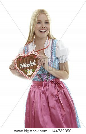 Woman with german Lebkuchen heart in front of white background