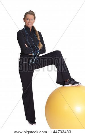 Exercise with a yellow rubber ball on white background