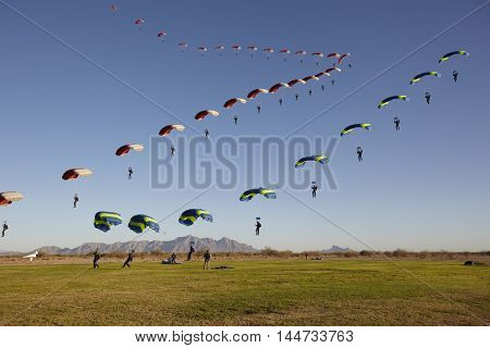 Compilation of Skydivers approaching for landing on daytime