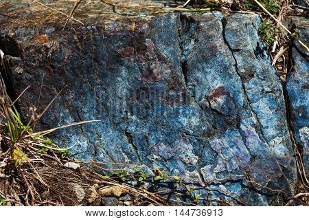 bluish piece of the rock in nature on mountain closeup