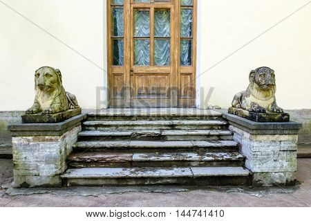 Saint Petersburg, Russia, August 18, 2016: Acient Royal sculptures of lions guarding the doors of the Pavlovsk Palace in St. Petersburg. Old staircase with lions. Historical landmark tourist destination of the middle ages in Russia.