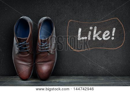 Like text on black board and business shoes on wooden floor