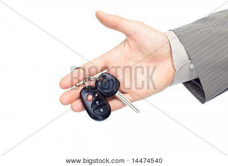 businessman holding car key. Isolated over white background