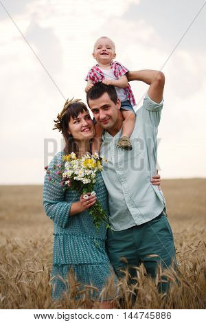 photo of happy family in the wheat field
