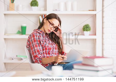 Concentrated Woman Using Laptop