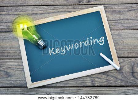 Keywording text on school board and glowing light bulb