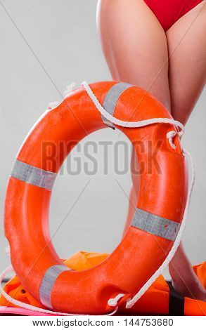 Life Buoy Ring And Female Legs