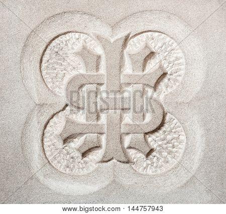 IHS Christogram symbol carved in granite stone.