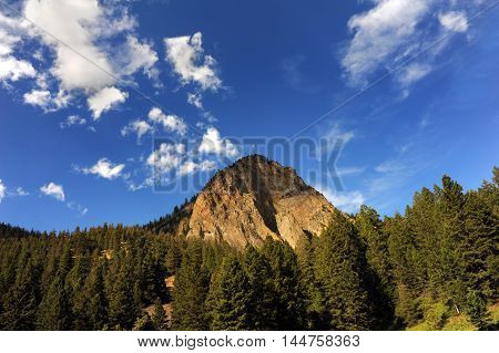 Rugged mountain peak in the Absaroka mountains rises into the blue skies near Paradise Valley Montana.