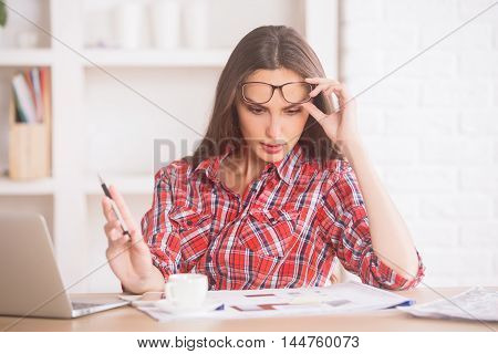 Young Businesswoman Doing Paperwork