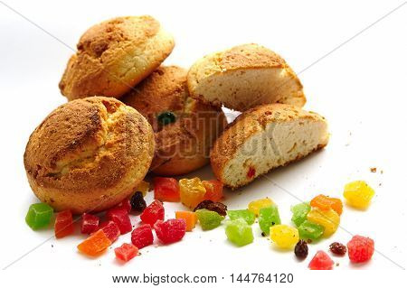 Cottage cheese biscuits with candied fruit on a white background