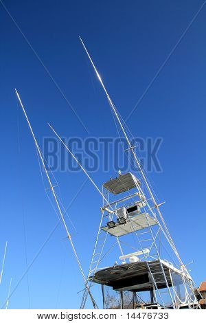 Flybridge fisher boat high fly bridge tuna tower on blue sky poster