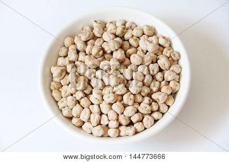 Raw chickpeas or kacang kuda in white bowl