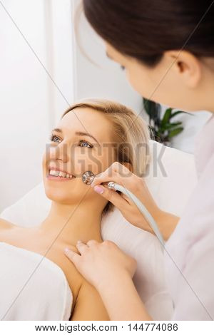 Facial peeling skincare young woman device clinic