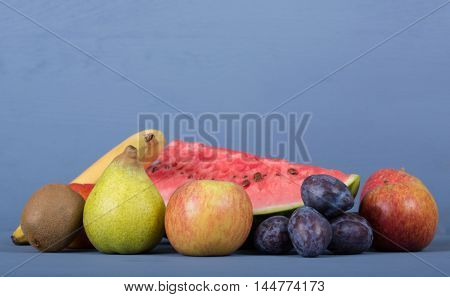 fruits on a blue wooden table, studio picture