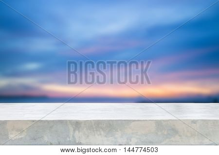 Concrete table top with sunset abstract blur background, stock photo