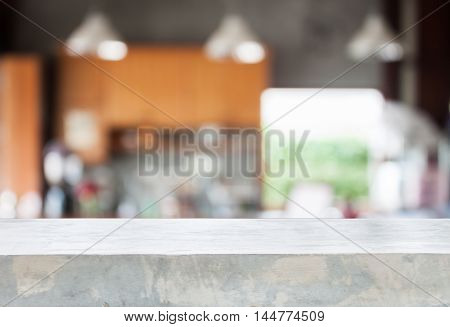 Concrete tabletop with abstract blur coffee shop background