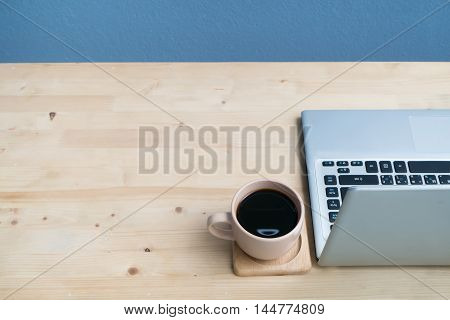Office desk with laptop and black coffee Selected focus on coffee cup.