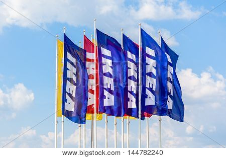 SAINT PETERSBURG, RUSSIA - JULY 28 2016: IKEA flags against sky at the IKEA Store. IKEA is the world's largest furniture retailer