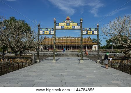 Hue, Vietnam-5 january, 2015: Entrance gate to Citadel Imperial Forbidden City with roayal palace in background Hue Vietnam