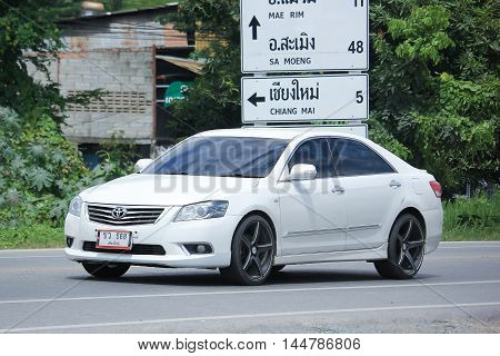CHIANGMAI THAILAND -AUGUST 9 2016: Private car Toyota Camry. On road no.1001 8 km from Chiangmai Business Area.