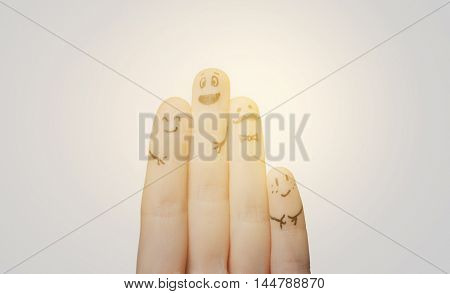 gesture, family, people and body parts concept - close up of two hands showing fingers with smiley faces