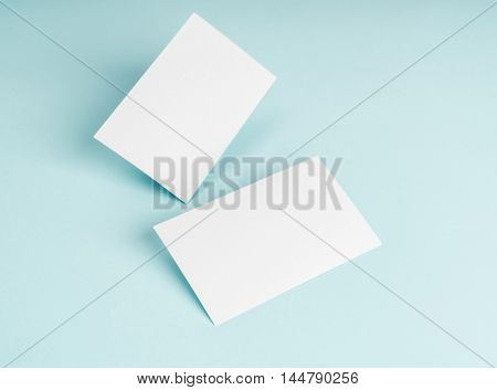 Blank business card on blue background