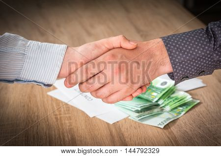 Business Partners Handshaking Over Successful Conclusion