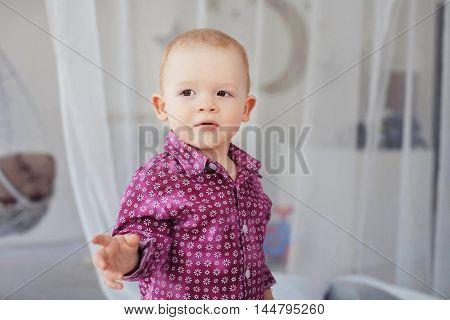 serious little boy. The concept of children