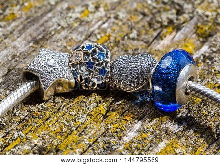 jewelry bracelet women on an old wooden surface modern fashion charms jewelry macro