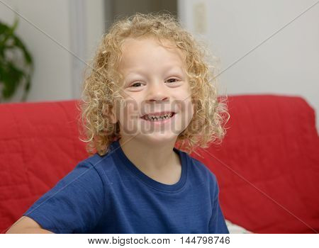 a portrait of a little boy with blond curly hair