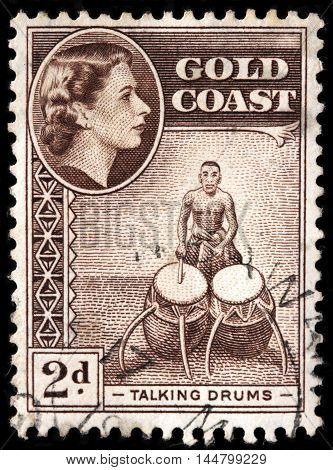 LUGA RUSSIA - JUNE 25 2016: A stamp printed by GOLD COAST shows Talking Drums - an hourglass-shaped drums from West Africa circa 1954
