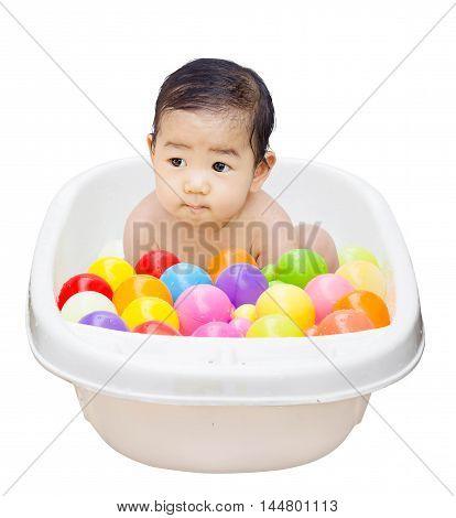 happy baby boy is bathed in white bath