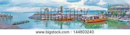 TIBERIAS ISRAEL - FEBRUARY 22 2016: The wooden pleasure boats in harbor on the Kinneret Lake on February 22 in Tiberias Israel.