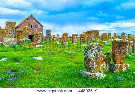 The large complex of Noratus Cemetery located at the bank of Sevan Lake among the green meadows of Gegharkunik Province Armenia.