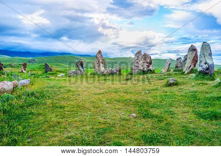 The huge boulders of Zorats Karer guard their meadow since old times standing like the brave knights among the highlands Syunik Province Armenia. poster