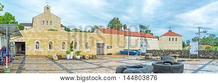 TABGHA ISRAEL - FEBRUARY 22 2016: Panorama of the Multiplication Church with the souvenir stalls located around it on February 22 in Tabgha.