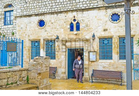 SAFED ISRAEL - FEBRUARY 22 2016: The facade of the medieval Ari Ashkenazi Synagogue built in memory of Rabbi Isaac Luria on February 22 in Safed.