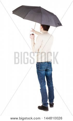 Back view of man in jeans under an umbrella. Standing young guy. Rear view people collection.  backside view of person.  Isolated over white background. A guy in a white warm sweater hiding from the