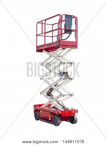 Mobile aerial work platform - red and white scissor hydraulic self propelled lift on a light background.