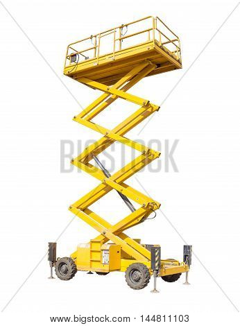 Mobile aerial work platform - yellow scissor hydraulic self propelled lift on a light background. poster