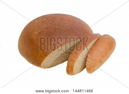 Partly sliced brown wheat and rye hearth bread on a light background