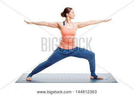 Woman doing Ashtanga Vinyasa Yoga asana Virabhadrasana 2 - warrior pose 2 isolated on white
