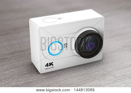 Small Ultra HD Action Camera on a wooden table. 3d Rendering