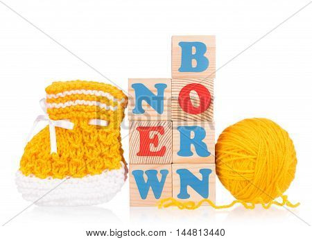 Cute little bootee with toy cubes isolated over white background