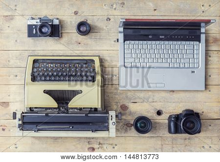 Journalistic equipment: typewriter, laptop, camera and lenses . Past and nowadays concept. Set of different objects.
