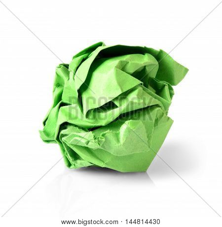 Green wrinkled paper ball isolated on white background symbol of recycling and wasting our resources.