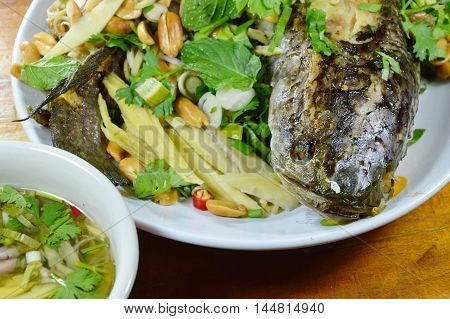 deep fried snake head fish with mixed herb dipping sweet sauce