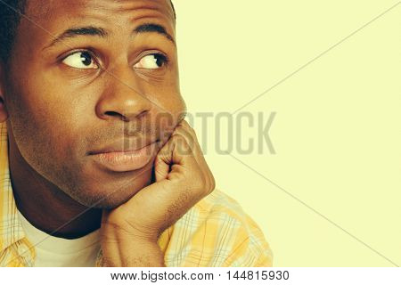 Young black man thinking with copy space